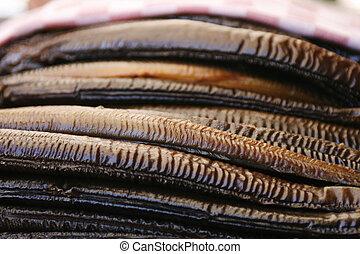 Smoked eels - Background of smoked eels.