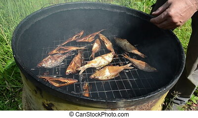 smoked fish delicacy - speed up fast scene man hand take...