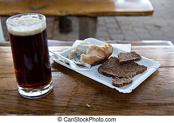 Smoked fish with black beer on Fischland in Germany