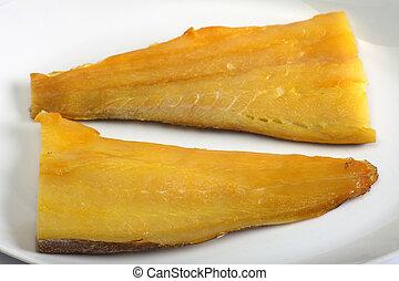 Smoked haddock horizontal - Two fillets of smoked haddock on...