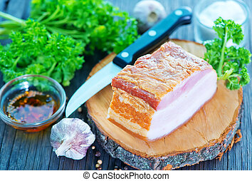 smoked lard with spice on the wooden board