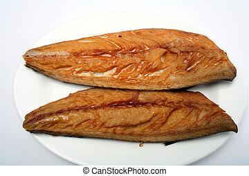 Smoked mackerel fillets - Two smoked mackerel fillets on a...