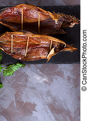 Smoked omul fish on the stone board