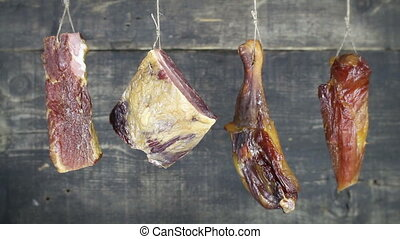 Smoked Pork and Chicken Meat Hanging on the Rope Against...