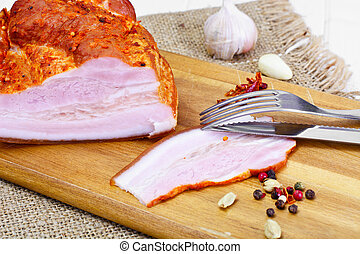 Smoked Pork with Spices on Wooden Cutting Board