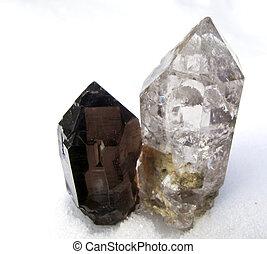 smoked quartz crystal on snow