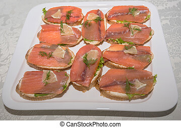 Smoked salmon canape on plate