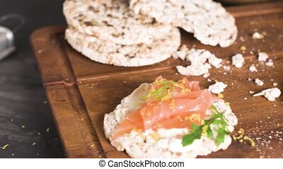 Smoked salmon on rice bread toasts - Delicious smoked salmon...