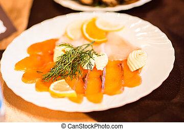 Smoked salmon platter at hotel breakfast.
