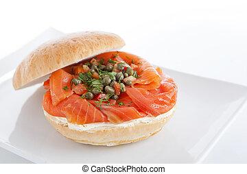 Smoked salmon sandwich on plate