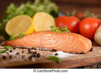 Smoked salmon slice on wooden board