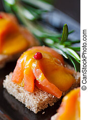 Smoked salmon. - Smoked salmon canape with sauce for party.