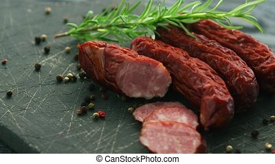 Smoked sausage and spices on board - Closeup shot of...