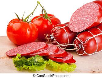 Smoked sausage - long loaf of smoked sausage lies on...