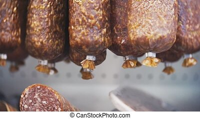 smoked sausage on the counter in the store. 4k. close-up.