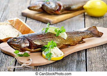 Smoked trout - A smoked rainbow trout served on a wooden ...