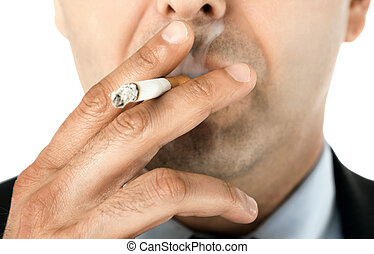 Close-up of man face holding cigarette and smoking