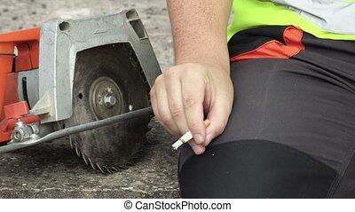 Smoker holding cigarette in hand