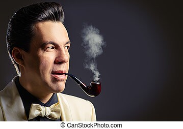 smokes a pipe - Imposing mature man with a haircut in the...