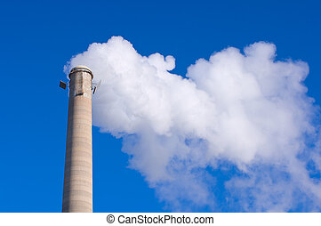 Smokestack and Gas Emissions Against Blue Sky - Industrial...