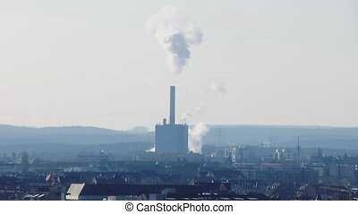 Smokestack of power plant - Power plant producing smoke...