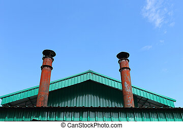 smokestack pollution with blue sky background