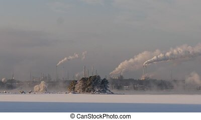 smokestack pollutions in sky. winter time