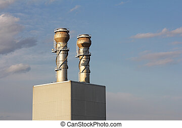 Smokestacks - An industrial power plant with tall smoke...