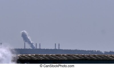 Smokestacks of factory tubes chimney smoke.