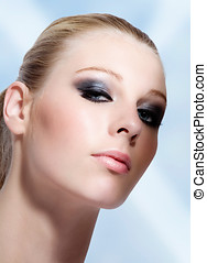 Smokey Eyes - Blonde woman with beautiful make-up on blue ...