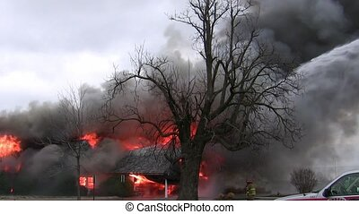 Smokey House Fire and Firemen - Firemen work on putting out ...