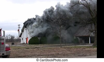 Thick smoke enveloped this home just before it burst into flames.