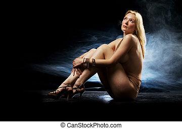 Smokey nude - Pale blond beauty naked in studio wearing...