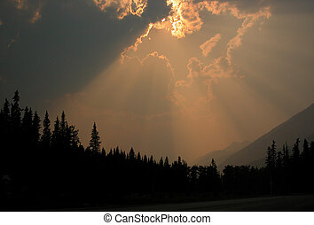 smokey sun - sunshine breaking through the clouds in Banff...