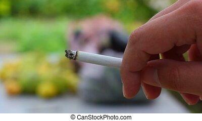 Smoking Addiction. cigarette in han