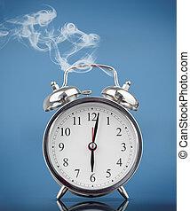 Smoking alarm clock on blue background