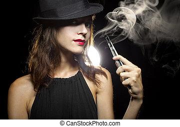 Smoking Alternative - woman smoking or vaping an electronic...