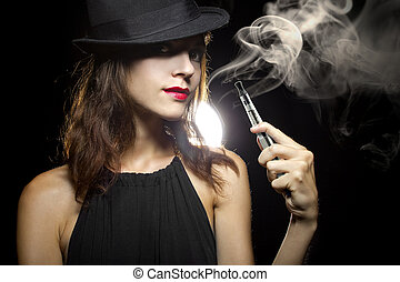 Smoking Alternative - woman smoking or vaping an electronic ...