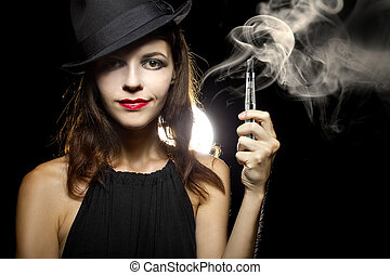 Smoking Alternative - woman smoking or vaping an electronic...
