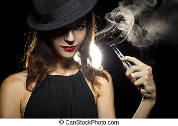Smoking Alternative - woman smoking or vaping an electronic ...