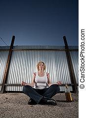 Smoking and drinking woman meditating