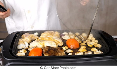 Smoking and steaming vegetables and meat on the grill
