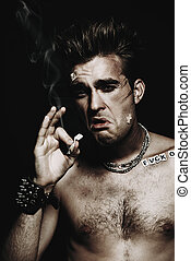 smoking bad boy - Antisocial behavior, bad habits. Portrait...
