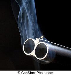 Smoking barrels - Both barrels of a double barreled shotgun...