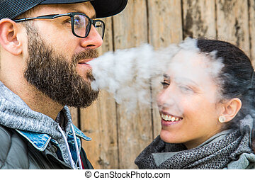 smoking bearded man with her woman