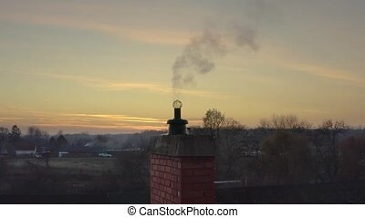 Smoking Chimney on a Roof - Smoking chimney of a house , ...