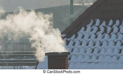 Smoking Chimney on a Roof - Smoking chimney, snowy roof slow...