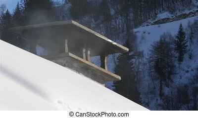 Smoking Chimney on a snowy roof