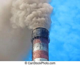 Smoking chimney smelter.