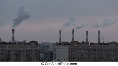 Smoking chimneys, city rooftops and a flying airplane - A...